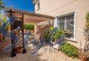 Semi-detached townhouse near the beach of Campoamor in private residential Montemar, Orihuela Costa, Costa Blanca, Spain