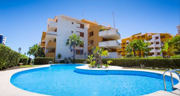 Apartments close to the sea with pool and garage in a gated urbanization Park Recoleta, Punta Prima, Orihuela Costa, Costa Blanca, Spain