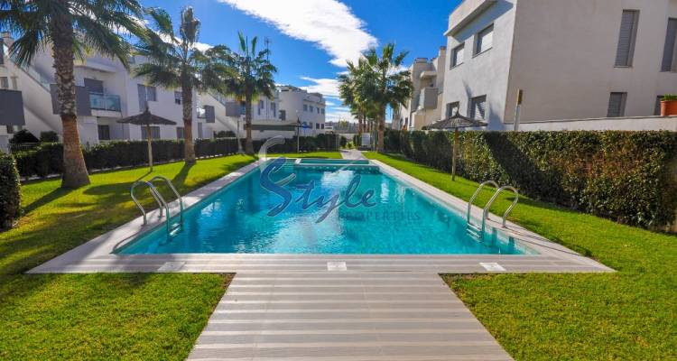 Apartments with private garden in a closed urbanization by the sea in Punta Prima, Orihuela Costa, Costa Blanca, Spain