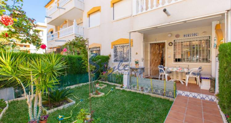 Apartment with large private garden and parking space just 200m from the beach of Punta Prima, Orihuela Costa, Costa Blanca, Spain