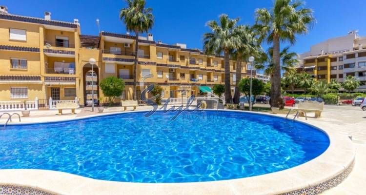 Beachside apartment just only 200 m from the sea in the urbanization of Punta Prima, Costa Blanca, Spain