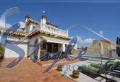 Detached two-storey villa with pool for sale near the sea in Cabo Roig